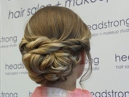 Blonde hair up-do with curly strands styled at Yardley, PA salon
