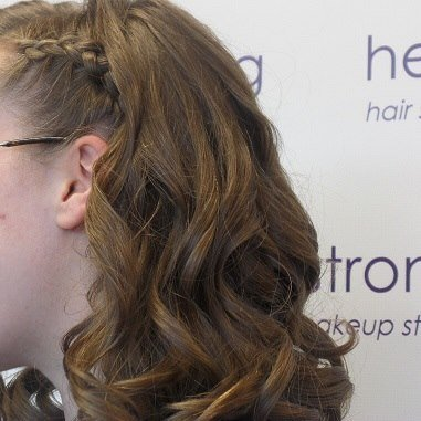 Curled brunette hair with a braid at Headstrong Salon
