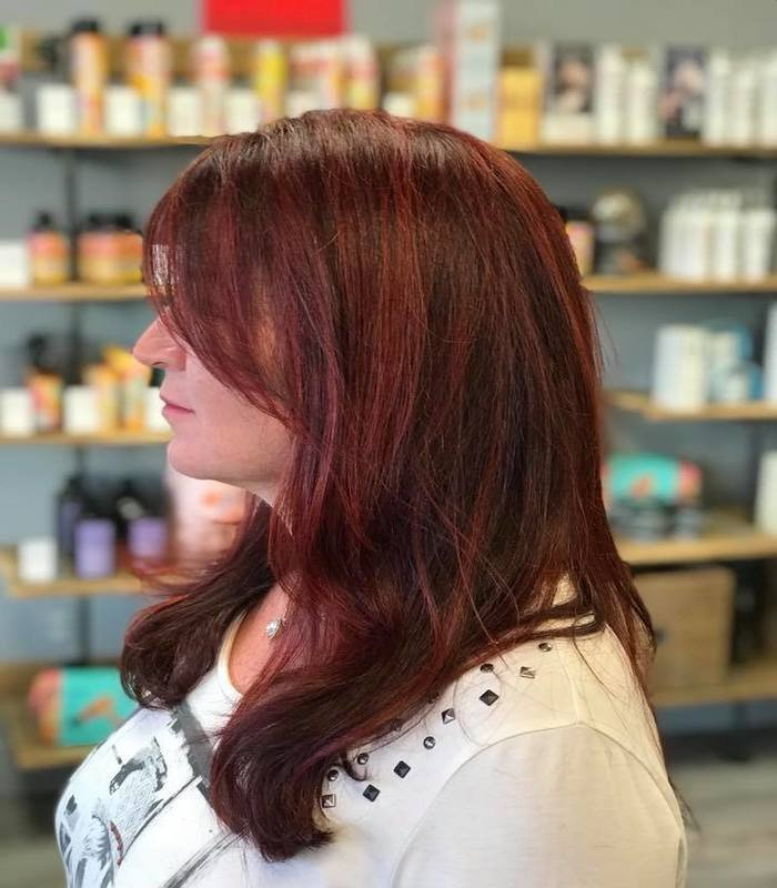side view of long layered haircut and color at Headstrong Salon in Yardley PA