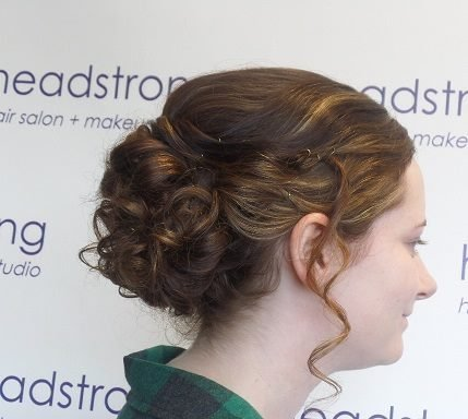 Up-do with curls hanging down at Yardley hair salon