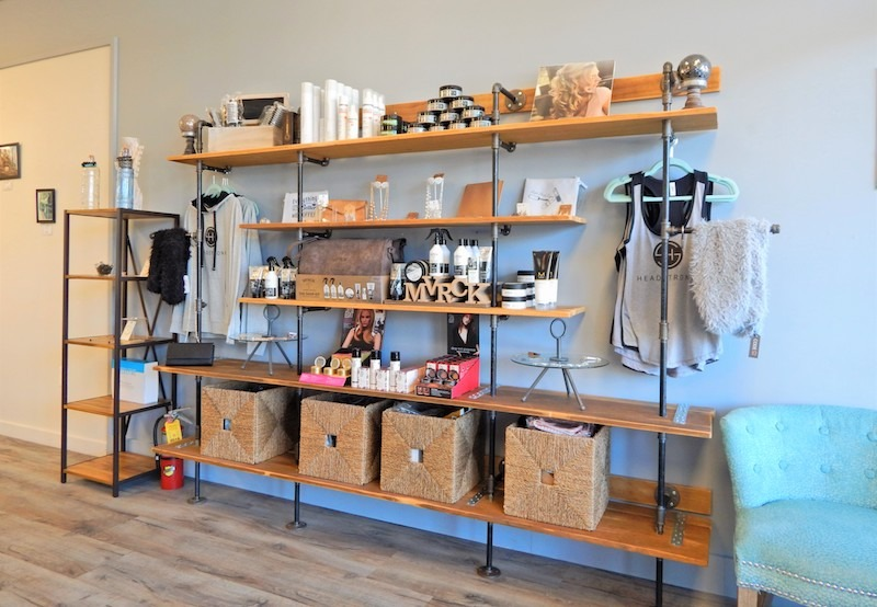 Products and clothing on shelves available for purchase at hair salon in Yardley, PA